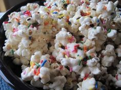 "Party Time Cake Batter Popcorn - or as a friend calls it ""that sinful, addictive stuff"". I am always asked for the recipe.    For Christmas I used a plain white cake mix and then added red and green sprinkles. I also adjust the recipe so it's not quite so sweet.  12 cups popcorn, 7 squares almond bark, 1/8 cup oil, 1 cup cake mix.  Once you start, it's hard to stop."