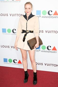 At a swanky Los Angeles event, Chloë Sevigny picked a zipped cardigan dress, leather boots, and a clutch featuring the house's famous monogram.