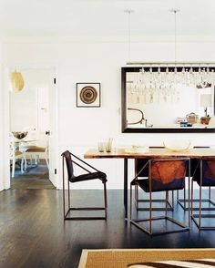 Pin for Later: 9 Ways to Fake Extra Square Footage With Mirrors In the Dining Room Instead of art, consider hanging a floor-length mirror horizontally to open up the space.  Source: Domino