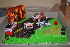 Sort of blended firetrucks and police cars for the whole party (police tape and flames for decor) and then all the vehicles on the cake. Rescue Vehicles Birthday Party Cake