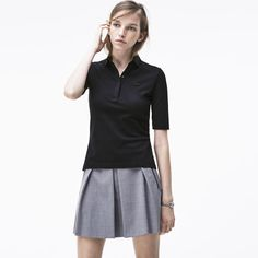 This black Lacoste polo stands out with its elbow-length sleeves and elegant look.