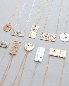 Map Necklace by Olive Yew. Our little horizontal map necklace keeps that one special place close to your heart.