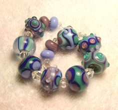 EKR - Lampwork Beads (12) Blues-Purples-Green Bead Set - SRA / Handmade Glass Beads / Beads for Jewelry / Jewelry-making / For Her by ekrulo on Etsy