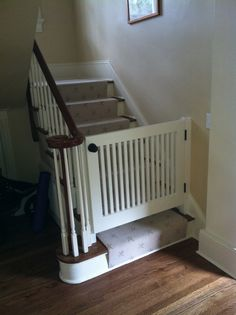 This handmade baby gate by Woods Cabinets is built to blend in with the look & feel of your living space. www.WoodsCabinets.com