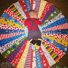 I made this quilt for Elijah & Aliyah and gave it to them a few months ago. As you can see Jonah has already begun to claim it for himself...