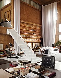 brick wall shelves and white staircase. loft