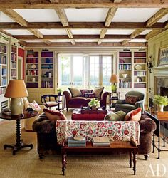 The family room of a farmhouse in Dutchess County, New York, contains a chesterfield sofa designed by architect Gil Schafer and upholstered in a Nancy Corzine velvet; the suzani throw is from Yellow Church Antiques   archdigest.com