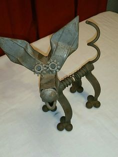 Recycled hand crafted Metal Garden Yard Art Dog, spring body