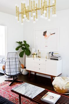 This modern lighting mixed with boho decor is one of our favorite combinations.