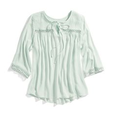 I like the look of this top! It looks very comfortable! I especially like the sleeves and neckline.