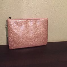 "NWT Kate spade clutch NWT Kate spade clutch/ cosmetic bag in rose gold 7"" tall and 10"" wide. No trades kate spade Bags"