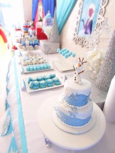 Lovely DESSERT TABLE at a Frozen Birthday Party via Kara's Party Ideas KarasPartyIdeas.com The Place for All Things PARTY! #frozen #frozenparty #frozenbirthdayparty #frozenpartyideas #disneyfrozen #winterparty #frozencake #desserttable