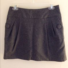 H&M Grey Wool Skirt This skirt is in great condition. It has a large button on either side (decoration only- they don't open) and an exposed zipper in the back. H&M Skirts Mini