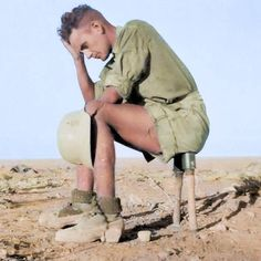 A German Afrika Korps trooper sits on two M24 Stielhandgranate hand grenades somewhere in the North African desert in about 1942. Although it looks precarious, the grenades could only have detonated once its end cap was removed and the internal cord pulled