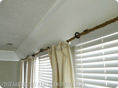 Use Rope to Hang Curtains Across Large Windows Rather Than Expensive Rods