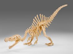 """Spinosaurus This puzzle is packaged in a reusable burlap bag. She has been precision cut from 3/8"""" (9.525 mm) stock and her joints are machined very tightly to insure that the puzzle will free stand a"""