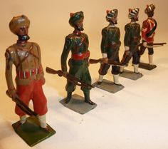 Lot 129 - Britains Indian Army at the trail one Britains SPECIAL PAINTING (G) three others with embellishments