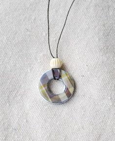 Step by step instructions for making darling washer necklaces. A fun and easy craft project!