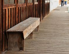 A wood bench seat is located on a old wild west themed wooden sidewalk for a very rustic photo. Stock Photo - 6231723