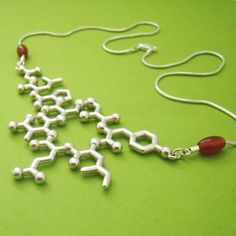 oxytocin - trust, bonding, and empathy  Sterling silver necklace featuring the molecular structure of oxytocin - a chemical released when bonding with a romantic partner, hugging your children or petting your dog - makes you feel like cuddling and is linked to empathy, trust and understanding