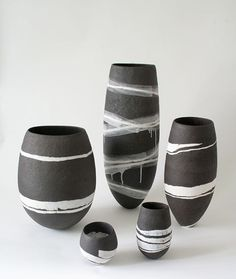"Gabriele Koch  |  Hand-built, burnished, smoke fired vessels (2012). ""All pieces are hand built and some are burnished to achieve a tactile surface. In some pots I have incorporated texture to create a contrast between rough and burnished surface areas. My most recent work sees a shift from low fired earthenware to high fired stoneware, combining rough black clay with white porcelain, giving me the opportunity to create strong graphic designs in contrasting colours""."