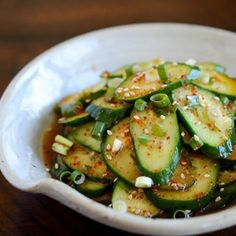 This dish is perhaps my most favorite as it contains cucumber, perfect for a hot summer day to cool off. The cucumber is sliced into pieces to be mixed with chilipaste, garlic, and scallions to be served right away. #cucumbersald #cucumberkimchi