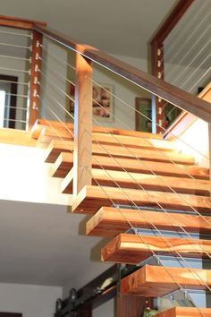 Combine the modern sleek look of cable railing with wood stainless steel or aluminum baluster options for a fully-customized look. The combination of textures and colors create unique contrasting beauty. These sturdy cable railing systems provide necessa Indoor Stair Railing, Cable Stair Railing, Stair Railing Kits, Interior Stair Railing, Modern Stair Railing, Stair Railing Design, Stair Handrail, Staircase Railings, Modern Stairs