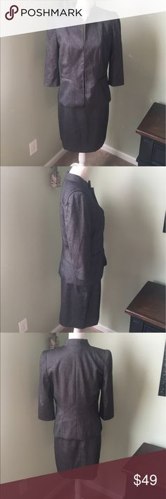 "Antonio Melani Charcoal Gray Classic Skirt Suit NWOT, excellent condition.  Size 8.  Charcoal gray color.  3/4 length sleeves.  Shoulder to shoulder measures 16"".  Skirt length 22"".  3 eyelet closures.  Skirt zipper in back w fake front pockets.  Offers welcome! ANTONIO MELANI Other"
