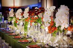 Orange, green and white table centerpieces