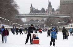 The Chateau Laurier is seen behind skaters on the the Rideau Canal Skateway on the first weekend of ... - THE CANADIAN PRESS/Justin Tang