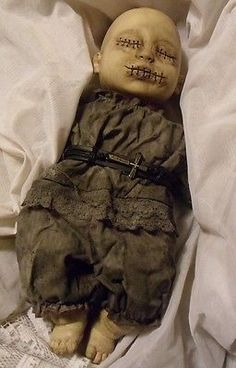 Use creepy doll head & limbs, make body with food (meat, nori wraps, rice paper wraps?
