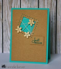 handmade card from the desert diva: Less is more : twine or string ... turquoise card with kraft panel ... tilted negative space square the random string pattern and three wood flowrs on top ... like the interesting and fresh design ...