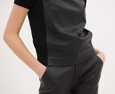 AR, LEATHER VERSUS KNIT TEE: leather bodice with constrasting knit side panels and sleeves.
