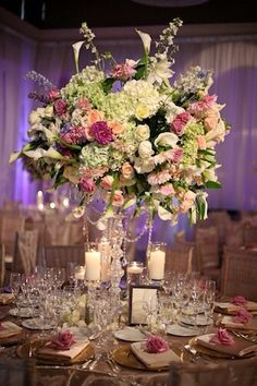 Love the little flowers on the place settings, and Wowzzzer centre piece.