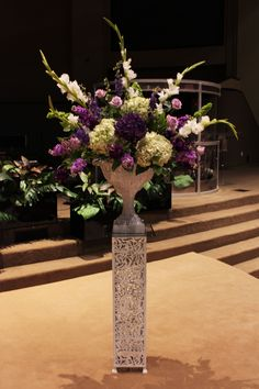 wedding flowers; altar flowers; bouquet arrangement; purple hydrangeas; white and green hydrangeas; purple weddings