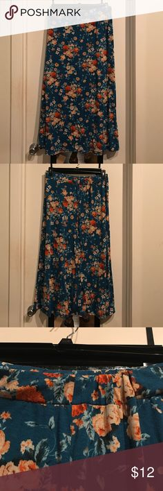 Pretty floral maxi skirt Hate to see this one go, but this skirt is stunning on the hanger and boho-chick worn. Some wear as it's gone through the dryer. Adding extra discount as the elastic band at the top is partially flipped in the back. Not a big deal and can be minimized when ironed. Open to offers. Xhilaration Skirts Maxi