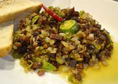 Pork Sisig - Top 10 Filipino Food - or our full top 10 Filipino food check here: http://live-less-ordinary.com/eating-asia/top-10-filipino-food-pinoy-food
