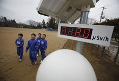 Students walk near a geiger counter, measuring a radiation level of 0.12 microsievert per hour, at Omika Elementary School, about 13 miles from the tsunami-crippled Fukushima Daiichi nuclear power plant, in Minamisoma, Japan, March 8, 2012. REUTERS/Toru Hanai