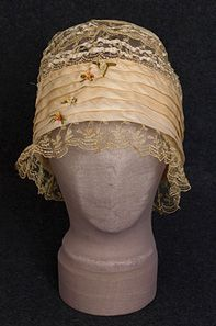 ~Silk and lace boudoir cap, 1920s. The front sports 4 silk ribbon bouquets. The back has a satin ribbon bow~