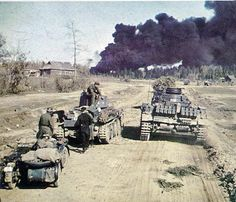 Panzer III and Panzer 38t outside a village in Russia during 1941's Barbarossa campaign. by GLORY. The largest archive of german WWII images, via Flickr