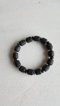 Finnish Aarikka vintage bracelet, made in Material black lacquered wooden beads, small metal beads and rubber band. Bracelet lenght is / Good condition. Metal Beads, Wooden Beads, Rubber Bands, Bracelet Making, Bracelets, How To Make, Etsy, Vintage, Jewelry