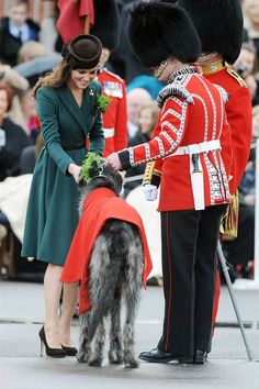 Catherine, Duchess of Cambridge, presents shamrocks to members of the 1st Battalion Irish Guards -- including the battalion's mascot, Irish wolfhound Domhnall -- at the St Patrick's Day Parade at Mons Barracks on March 17, 2013, in Aldershot, England.