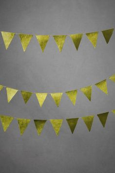Wee triangles in a bright olive populate a span of hemp string. Lokta paper, hemp string. Handmade in Nepal.