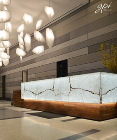 in the swanky lobby of The Hub a residential high rise in Brooklyn NY a backlit onyx reception desk . Hotel Reception Desk, Office Reception Design, Modern Reception Desk, Lobby Reception, Reception Counter, Wedding Reception, Interior Design Portfolios, Office Interior Design, Luxury Interior Design