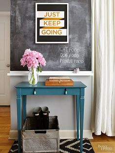 Make a miniscule wall noteworthy with a chalkboard and motivational artwork. Crates and baskets keep shoes organized beneath a small console table. Bonus: Peonies make everything prettier./
