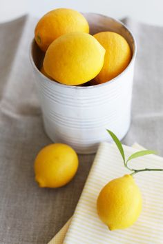 Use whole lemons as place cards, by just writing guests names on them. They're subtle but they smell great, and it's a little hint towards the lemon pie coming for dessert. Plus, you can run them through the garbage disposal afterward during clean-up. #saveur #dinnerparty