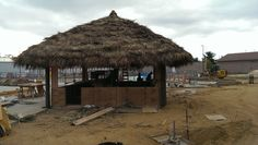 West Berlin, NJ: Sahara Sam's Oasis Indoor & Outdoor Water Park Done in 5 days. I'm exhausted. Framing was done when I came onto the job. We thatched a 26 x 26 Tiki Bar and 16 - 10x10 Tiki Huts. Full photo album can be seen here on facebook - https://www.facebook.com/tikikev/photos_albums . For more info go to www.tikikev.com or contact me directly at 800-792-8454 , or email to tikikev@tikikev.com