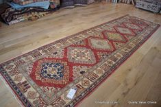 Hand Knotted Kazak Super Runner from Afghanistan. Length: 301.0cm by Width: 82.0cm. Only £803 at https://www.olneyrugs.co.uk/shop/runners-for-sale/afghan-kazak-super-17423.html    Take a gander at our distinguished variety of kilim carpets, kilim ottomans and Kilim cushion covers at www.olneyrugs.co.uk