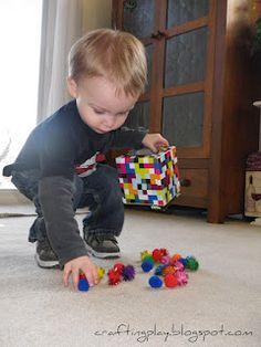 tissue box play - pom poms - fill and spill