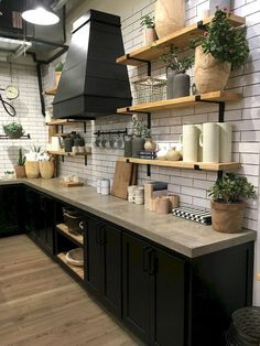 Beautiful farmhouse style kitchen at Magnolia Market. 5 Things to Know before you visit Magnolia Market Black Kitchen Cabinets, Kitchen Cabinet Design, Black Kitchens, Kitchen Layout, Interior Design Kitchen, Cool Kitchens, Kitchen Black Appliances, Kitchen Colors, Kitchen Island